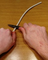 OneCup OneLife - Cutting the plastic around the wires with a knife 1.jpg